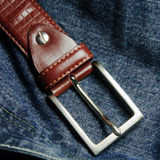 Belt. Blue jeans and leather belt Stock Photos