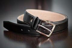 Belt. A black belt on a table Royalty Free Stock Photo