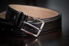 Belt. A black belt on a table Royalty Free Stock Images