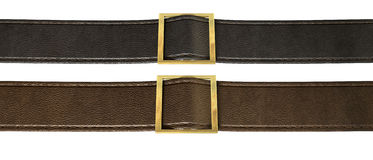 Belt And Buckle. Two side-by-side seamed leather strips in black and brown threaded through a gold belt buckle on an isolated background Royalty Free Stock Photography