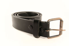 Belt and Buckle. Belt strap and buckle wrapped up on a white background Royalty Free Stock Image