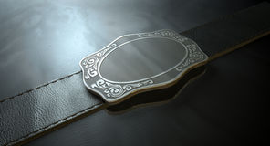 Belt Buckle And Leather. A seamed leather belt threaded through an ornate cast iron belt buckle on an isolated background Stock Photo