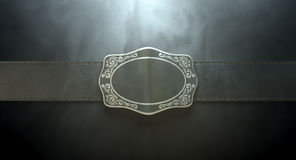 Belt Buckle And Leather. A seamed leather belt threaded through an ornate cast iron belt buckle on an isolated background Stock Photography