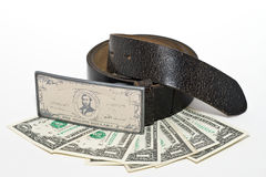 Belt, buckle and some dollars Stock Images