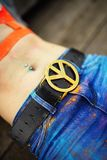 Belt buckle with symbolics of hippie - peace Stock Photos