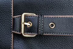 Belt buckles and textured black leather. Stock Photos