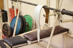 Belt and colourful weights for powerlifting Royalty Free Stock Photo