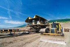 The belt conveyor and bulldozer Royalty Free Stock Images