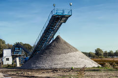 The belt conveyor. The conveyor belt of sand in gravel pit Royalty Free Stock Images