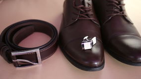 Belt, cuffinks and brown shoes stock video footage