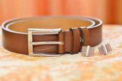 Belt and cufflinks Stock Image