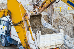 Belt excavator loading a big dumper Royalty Free Stock Images