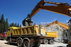 Belt excavator loading a big truck Royalty Free Stock Photos
