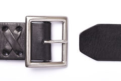 Belt with a fastener isolated. Black belt with a fastener isolated on a white background royalty free stock photo