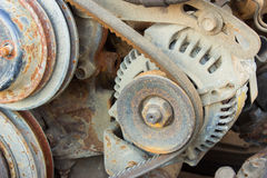 Belt of the generator and an old car generator Royalty Free Stock Photo