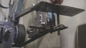 Belt grinder being operated by a worker stock video footage