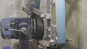 Belt grinder being operated by a worker