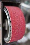 Belt grinder continue. Close-up of belt grinder continue Stock Images