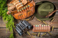 Belt with hunter bullets and binocular Stock Photography
