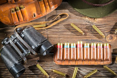 Belt with hunter bullets and binocular royalty free stock image