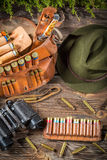 Belt with hunter bullets and binocular Royalty Free Stock Photos