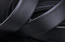 Belt. Male belt close-up isolated on black background stock photo
