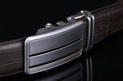 Belt. Male belt close-up isolated on black background stock photography