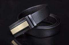 Belt. Male belt close-up isolated on black background royalty free stock image