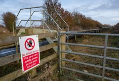 No Public Access sign seen close to a conveyor belt used for quarrying aggregates Royalty Free Stock Image