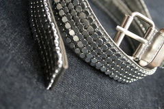 Belt over velvet background. Silver belt over velvet background Royalty Free Stock Image