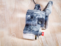 Belt sander at finished ashwood furniture board Royalty Free Stock Photo