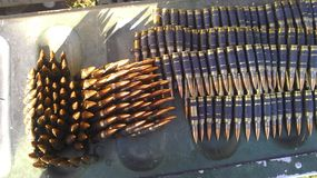 5.56 In Belt. SAW 5.56mm Ammunition waiting on humvee to be used Stock Images