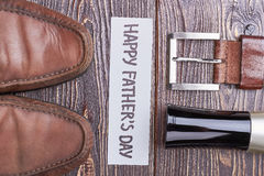 Belt and shoes on wood. Royalty Free Stock Image