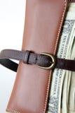 Belt tighten wallet. Brown belt tighten brown wallet Royalty Free Stock Photos