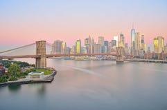Belt of Venus over a New York City. Manhattan skyline with Brooklyn Bridge at sunrise Stock Photos