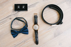 Belt, watches, Cufflinks and bow tie Stock Images