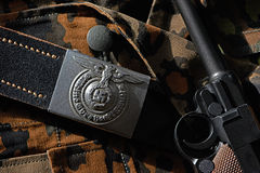 Belt Wehrmacht soldier and pistol Parabellum on camouflage unifo Stock Photo