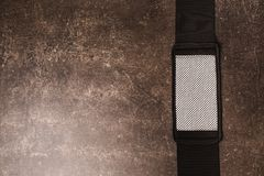 Belt for weight loss on a dark marble background. Relieve weight royalty free stock photo