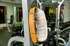 Belt of the weightlifter. Hanging in the gym stock images