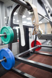 Belt and weights for powerlifting. Belt and colourful weights for powerlifting on a rack Stock Photos