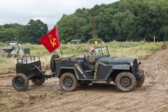 Russian military jeep and trailer. BELTRING, UK - JULY 26: An ex Russian army jeep and trailer heads around the main show arena for the public to view at the War Royalty Free Stock Photography