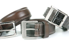 Belts. Brown belts isolated against a white background royalty free stock photography