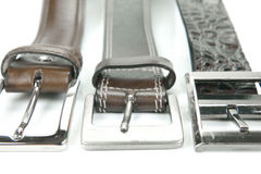 Belts. Brown belts isolated against a white background stock photo