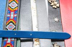 Belts. Lots of leather belts ligned up together royalty free stock photos