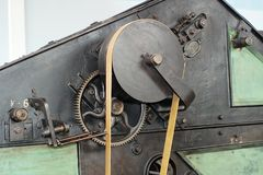 Belts and pulleys in an old cotton processing factory. Belts and pulleys on historic machinery that was used to produce cotton cloth at the Fabrica Imbabura Stock Photo