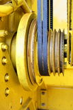 Belts and pulleys. Yellow engine transmission from wedge belts and pulleys Royalty Free Stock Images