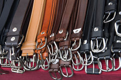 Belts for sale. On a French market stock photo