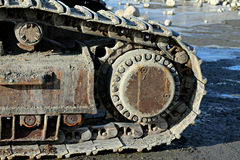 Excavator belts. The belts and wheels of an excavator Royalty Free Stock Photo