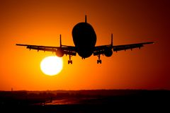 Beluga airplane silhouette in the sun , final approach on runway. Airbus A320 airplane silhouette at sunset , final approach landing in Bucharest Stock Photo
