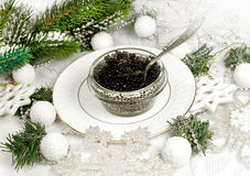 Beluga caviar and Christmas decor. Tasty food beluga  caviar on a holiday and Christmas decor Stock Photography